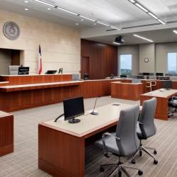 Individual desk-top mounted speakers are at all key positions in the courtrooms including witness, judge and counsel positions, and an overhead distributed speaker system provides audio support to the jury and audience areas of the courtroom.
